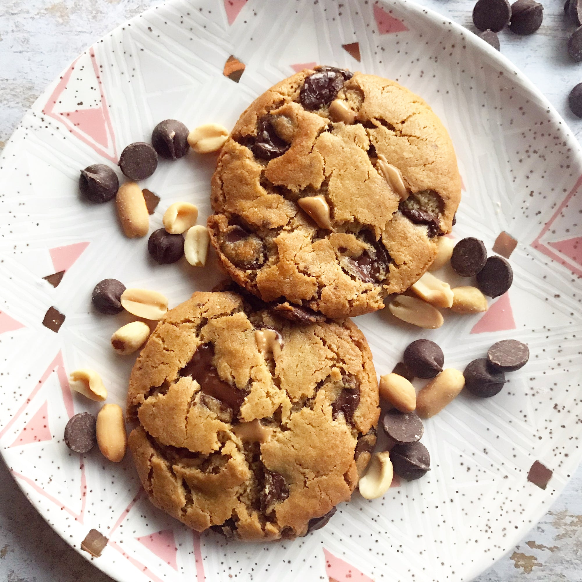 The Naughty Cookie Vegan Peanut Butter Chocolate Chip cookies. Consists of Organic Peanut Butter and Chocolate Chips mixed into The Naughty Cookie signature cookie dough and dusted off with Sea Salt Flakes.