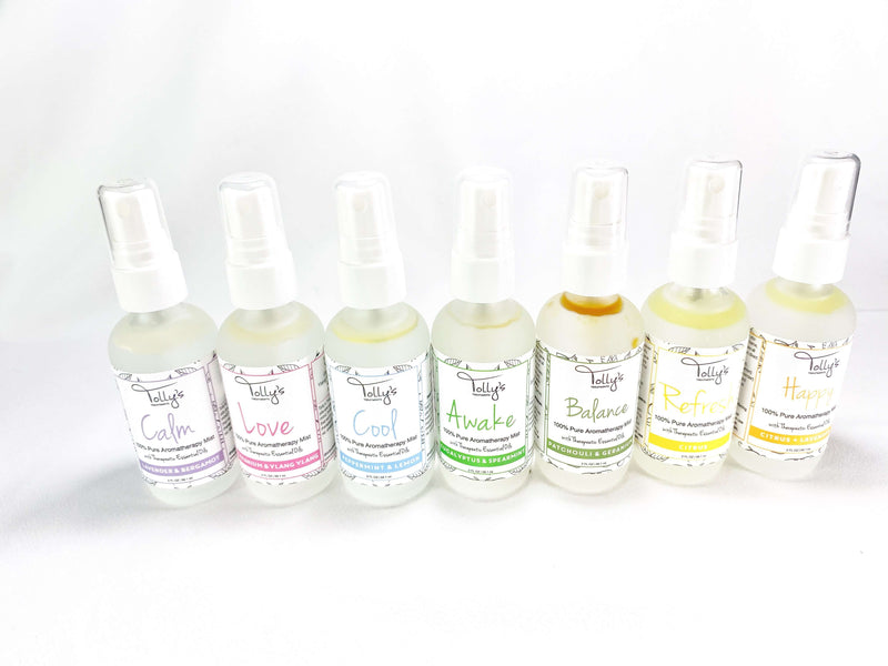 7 Aromatherapy Mists: Love, Calm, Cool, Awake, Happy, Balance and Refresh in a standing position showing the front of the bottles.