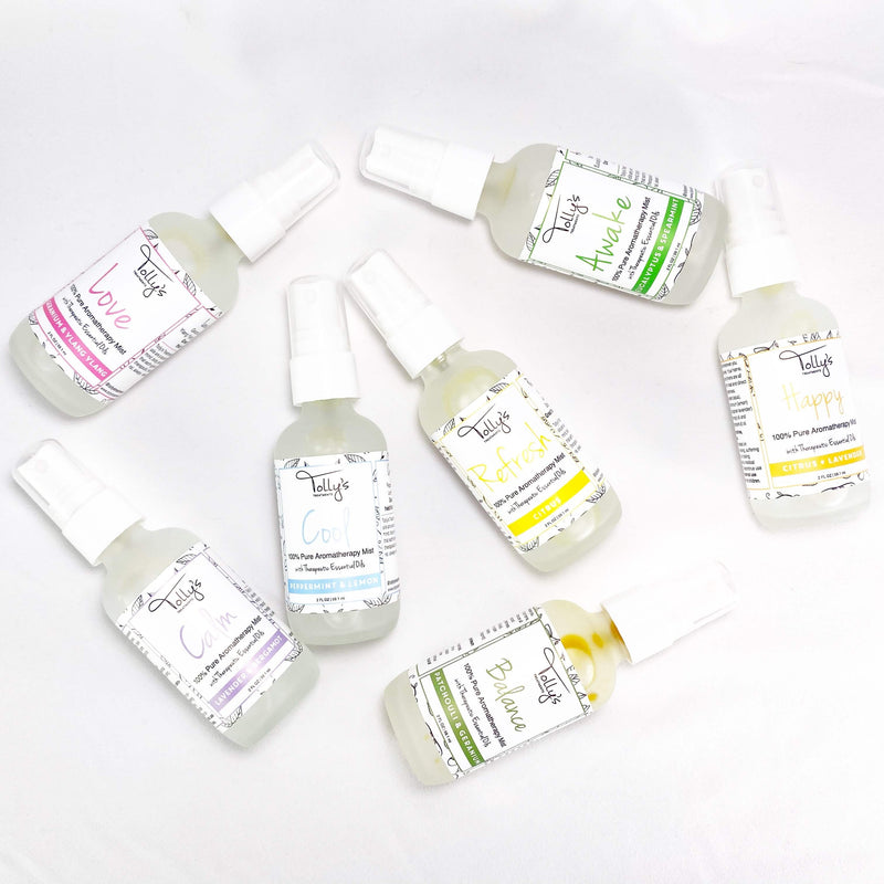 7 Aromatherapy Mists: Love, Calm, Cool, Awake, Happy, Balance and Refresh in a sideways position showing the front of the bottles.