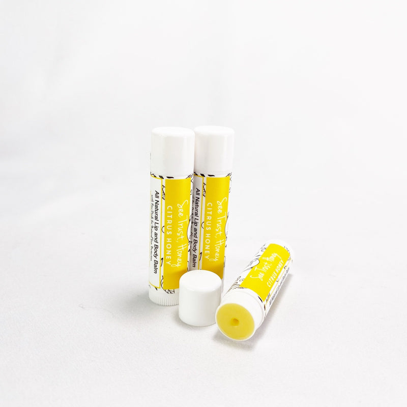 See trust honey lip balms - 3 pk citrus honey, un capped to see the balm.