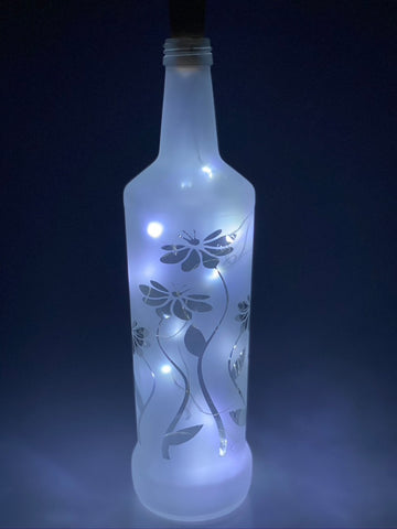 Upcycled Glass bottle featuring flowers with pretty lights