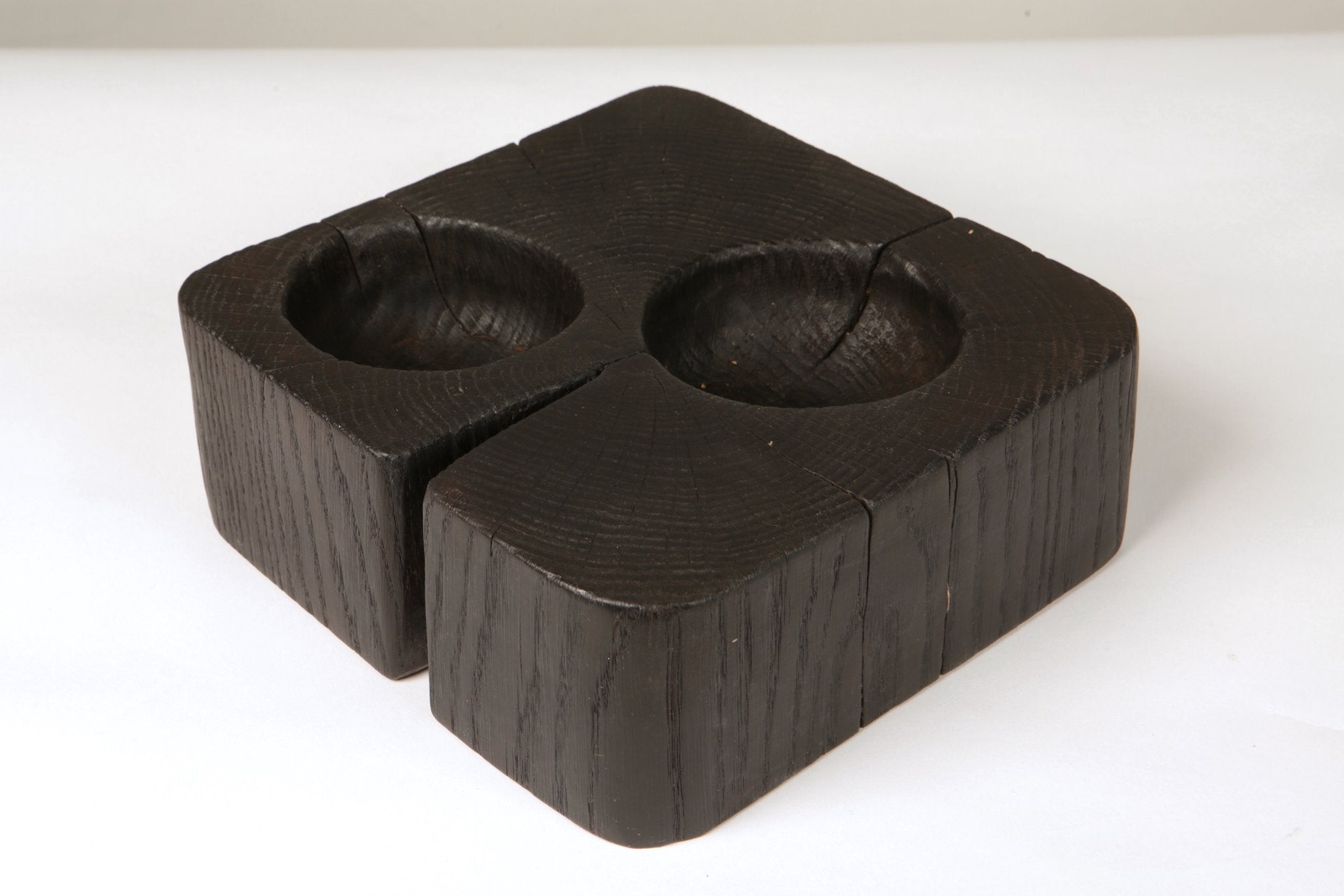 Oak wooden hand made bowl in black and has two bowls hand crafted inside