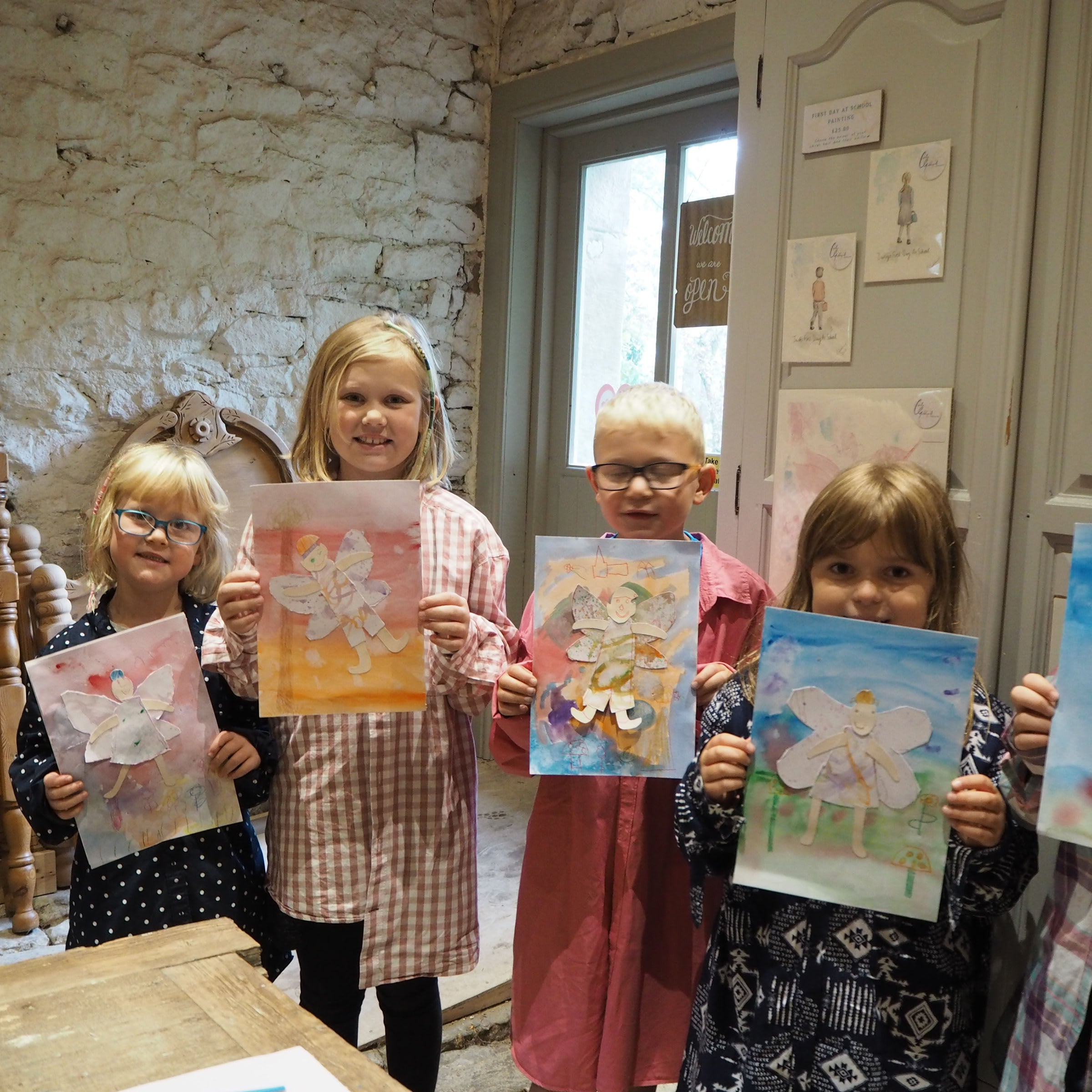 Children holding their artwork