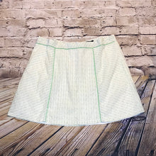 Load image into Gallery viewer, Torrid white mini tennis skirt with green and yellow polka dots and lime green piping.