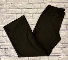 Load image into Gallery viewer, Maurices black active pants with wide yoga leg.  Stretchy with a few hemlines across legs for detail.