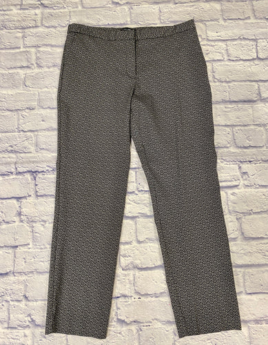 Mario Serrani black and white patterned slacks with hook and zip closure.  Very fitted but good stretch, 74% rayon, 22% nylon, and 4% spandex.  Two side slit pockets.  Back pocket slits for decoration.