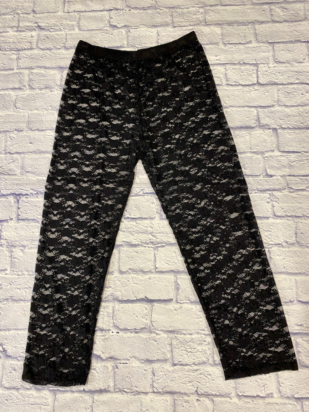 Black lace leggings with elastic waistband.  Sheer, delicate lace.
