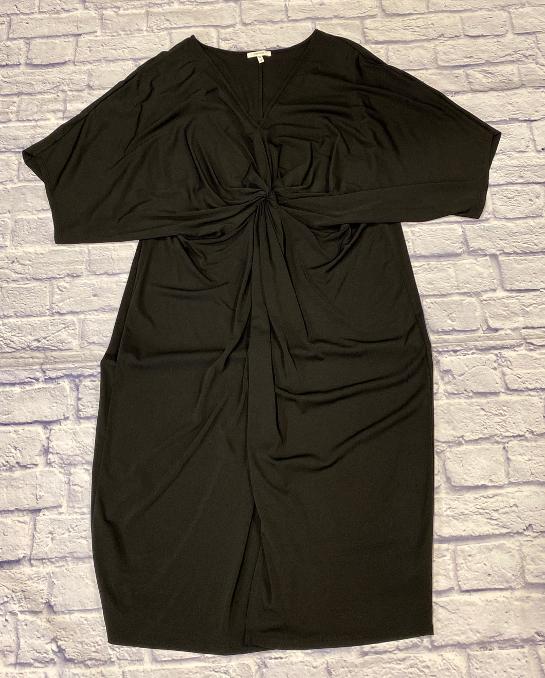 Maurices black stretch dress with v neck into knotted front.  Very flattering.  Straight through hip.  Like new.