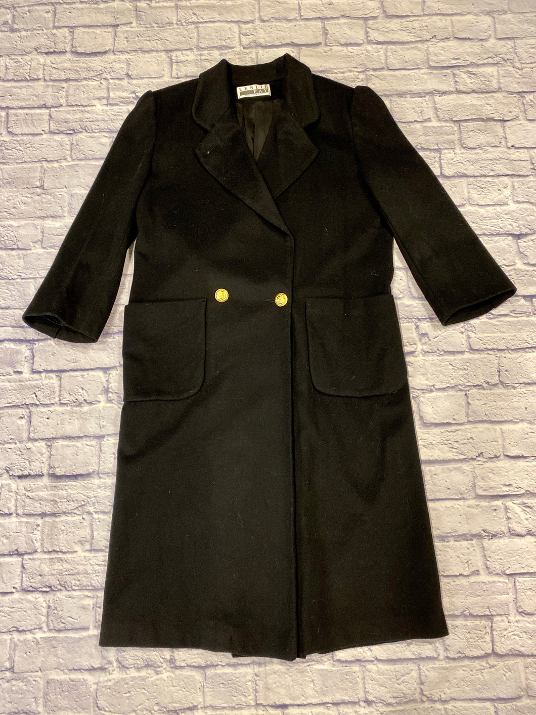 Leslie Fay vintage black wool trench coat with square padded shoulders and gold button accents.  Two front square pockets.  Oversized look.  Very on trend.