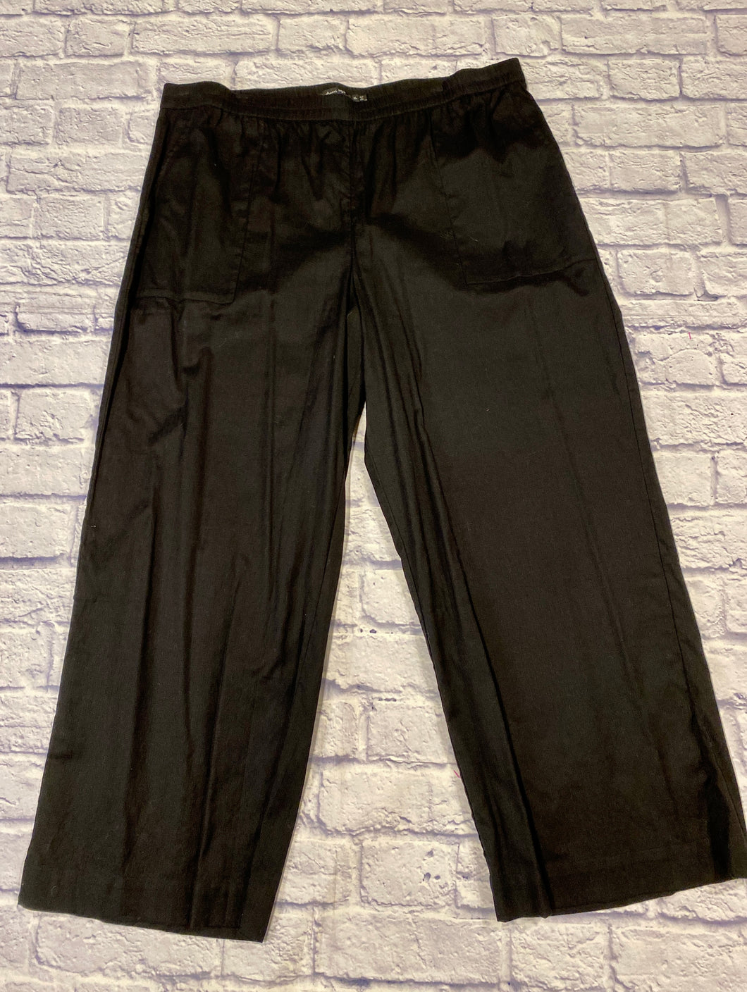 Gundrun black linen pants with elastic waistband and two side pockets.  Wide leg hems.  Like new!