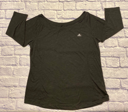 Adidas climalite long sleeved black active top.  Small logo on top left shoulder.  Banded bottom hem with slight boat neck.  ClimaLite wicking technology helps evaporate moisture.