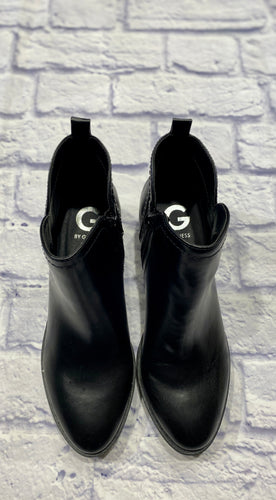 Guess black leather side zip booties.  New in box. Almond toe, logo inside.