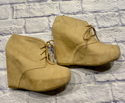 Soda tan suede wedge booties with lace up front.  One seam running down sides.