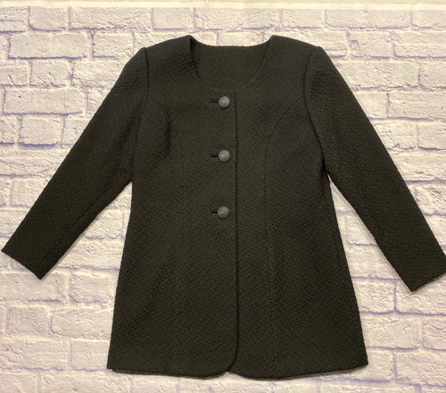 Black single breasted coat with three buttons down front.  Textured fabric and two side pockets.  No collar, scoop neckline.  Light grey satin lining.  Great tailoring.  Very cool.