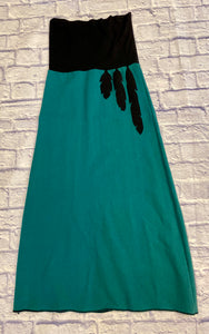 Emerald green heavy cotton maxi skirt with wide jersey knit waistband in black and felt black feather down the front left.  Exposed seam stitching at hemline.