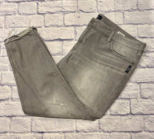 Silver brand jeans in faded gray with distressed skinny hem.  Mid rise, ankle length.  Button and zip closure.