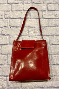 Hobo International red leather shoulder bag.  Rectangle shape with short shoulder strap and magnetic closure.  Lime green interior lining.  Precious!