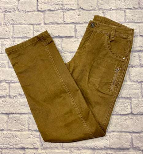 Kuhl utility pants in light brown.  Heavyweight cotton with multiple pockets and hammer loop.  Button and zip closure, straight legs.
