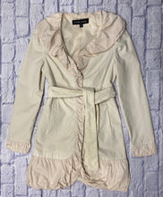 Load image into Gallery viewer, Black Noir cream mid length lightweight trench with pretty ruffle detail on collar and sleeves.  Snap closure and belt waist tie.  So cute!