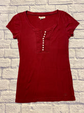 Load image into Gallery viewer, Aeropostale maroon t-shirt with pleat detail and half buttons up front.  Logo on left hip hem.