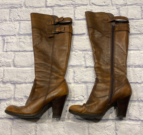 Børn brown soft leather knee high boots with two calf straps.  Full side zip opening.  Two inch heels.  Soles like new.  Small nicks on back of each heel.  Very cute!