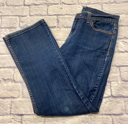 Levi's medium wash denim jeans with button and zip closure.  Bootcut hem and mid rise.