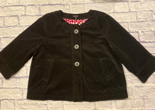 Madison black ribbed bolero jacket with three button front.  3/4 sleeves and two slant side pockets.  Interior lining is hot pink and white abstract polka dots.  So cute!