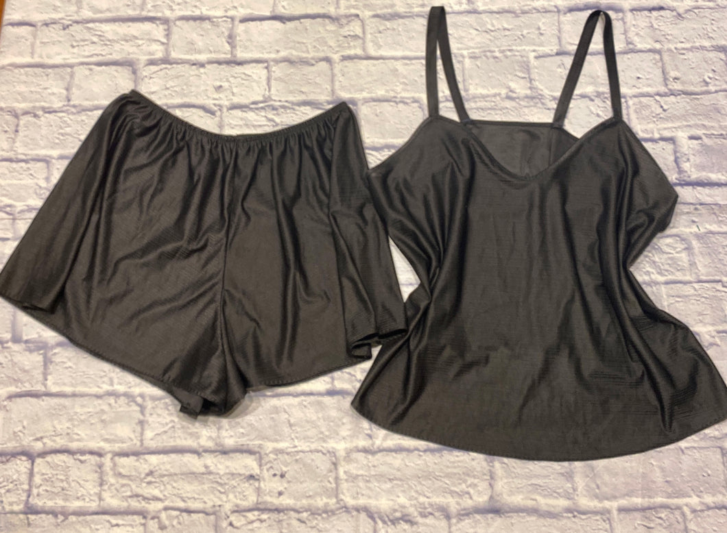 Petra Fashions black satin sleep set, slightly textured ribbed.  Shorts with elastic waist.  Cami with medium width straps and curved V neck.