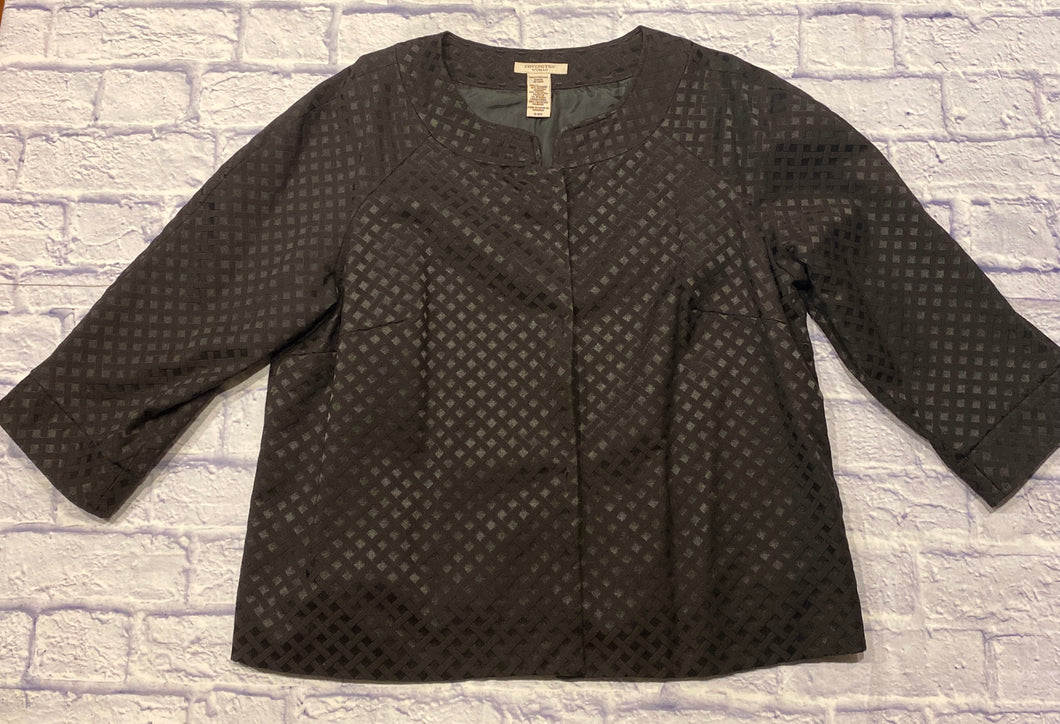 Covington black cropped jacket with triangle pattern in black.  3/4 sleeves with front pleating.  Mandarin collar.  Black interior lining.