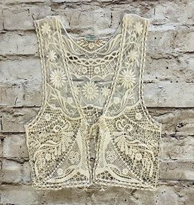 Delicate, sheer lace tie front tank.  Intricate pattern detail.
