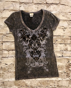 Buckle distressed black t-shirt with decorative front pattern.