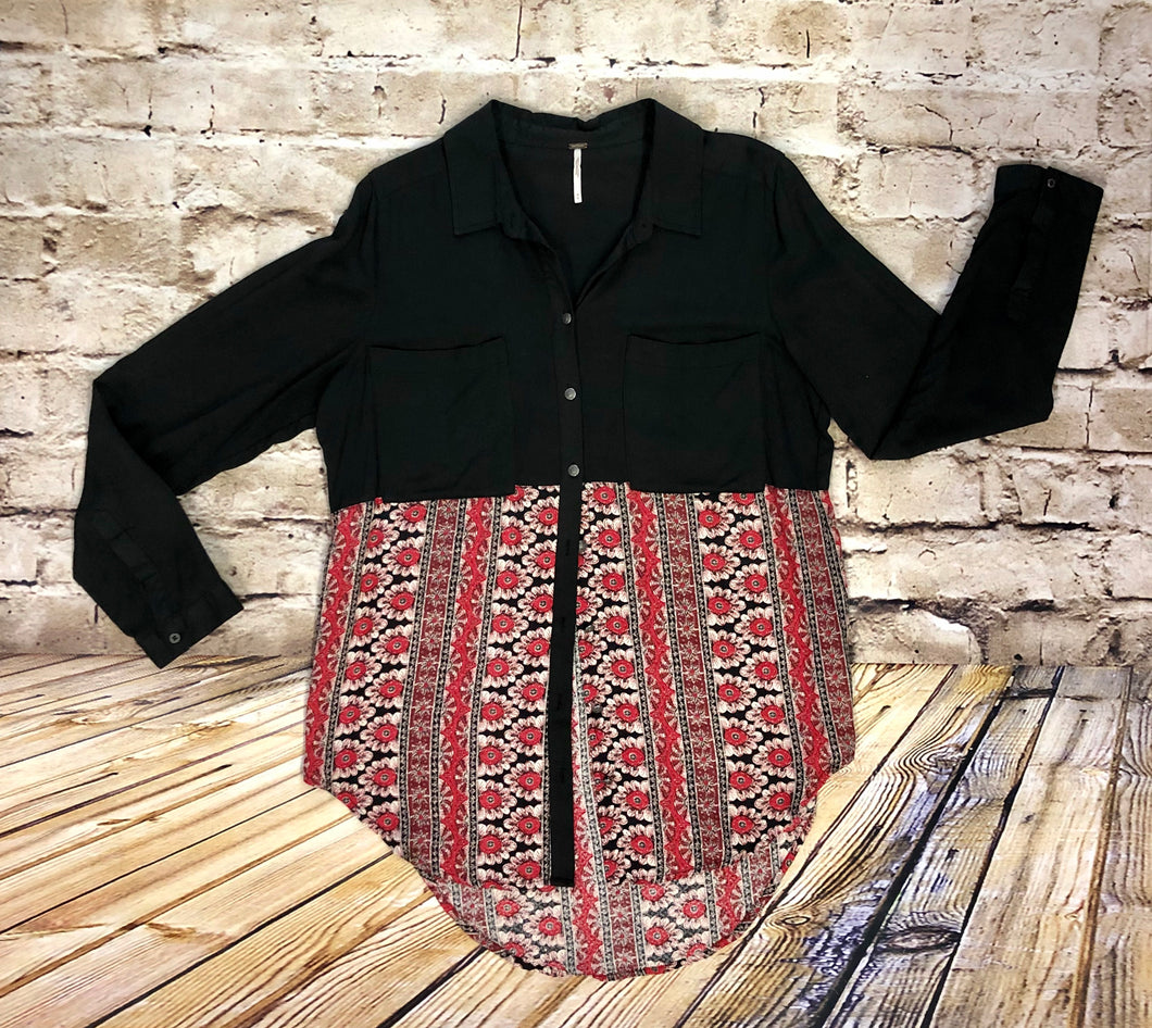 Black upper button down tunic with red floral pattern finish.  Double breast pockets.