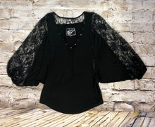 Load image into Gallery viewer, Norsdstrom 3/4 bell capped sleeve black jersey blouse with lace sleeves and brass detail on neckline.