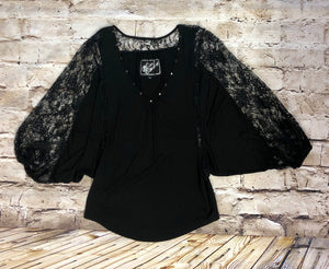 Norsdstrom 3/4 bell capped sleeve black jersey blouse with lace sleeves and brass detail on neckline.