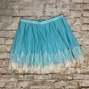 Adorable Torrid blue sheer overlay mini with lace hem detail and satin waist cuff.