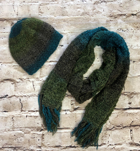 Knitted cap and scarf set in greens and blues.