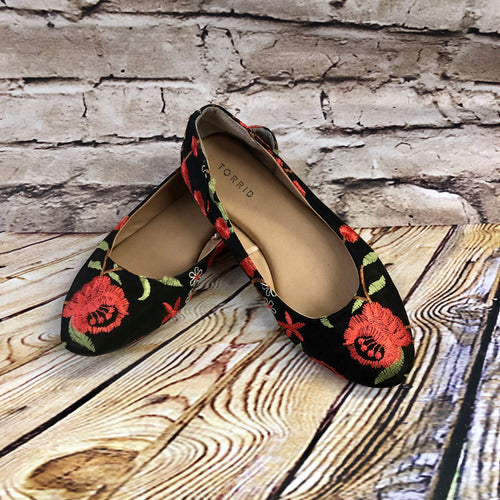 Torrid black flats with red floral embroidery and green foliage.  Like new.