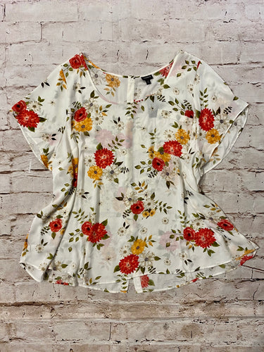 Torrid white short sleeved blouse with red and yellow floral design and button up back.