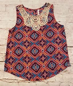 Xhilaration pink, blue, and purple aztec print tank with cream lace collar detail and button closure in back.