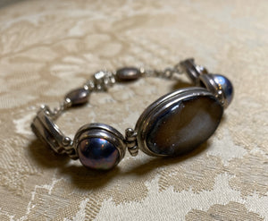 Druzy and purple pearl bracelet set in sterling silver with magnetic clasp and safety chain.