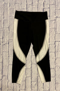 Avia black, grey, and white active leggings.  Pockets on both sides with elastic waist.