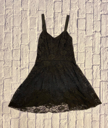Free People lace dress in black with navy blue accent band around skirt.  Black underlining, adjustable straps, and side hidden zipper.