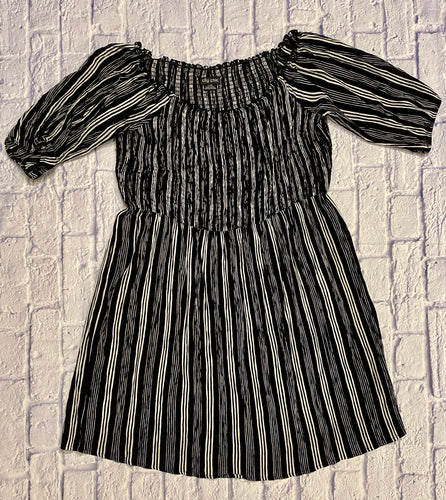 City Chic black and white vertical striped dress with 3/4 sleeves and elastic ruched neckline.  Very stretchy.
