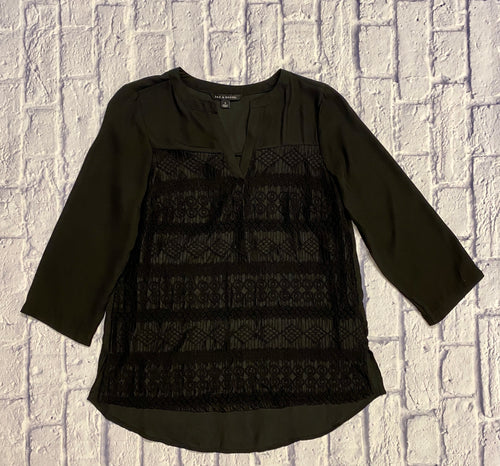 Zac & Rachel black lace 3/4 sleeve blouse. Crew neck has a V-shape drop and the front features lace paneling. The back is without lace and is slightly sheer. There are slits on the sides at the bottom of the blouse.