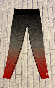 Marika ombre active leggings, black to grey to red with pinstripes.  Black wide elastic waistband.
