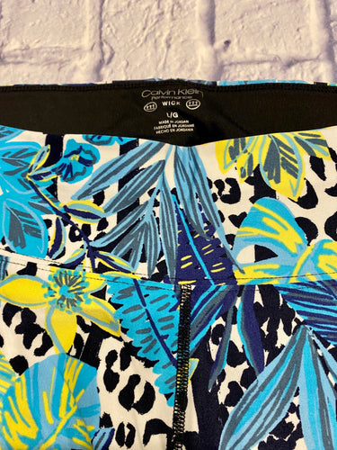 Calvin Klein Performance wick active leggings with tropical vibe in blues and yellows.  Black seams.
