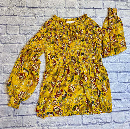 Rose + Olive bright yellow blouse with maroon, tan, green, and white floral pattern.  Tie neck detail, elastic bodice and sleeve hems.