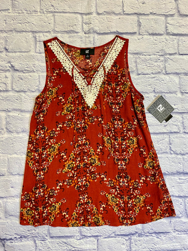 IZ Byer red tank with black, tan, and green floral pattern.  Lace v neckline hem and criss cross tie.  NWT.