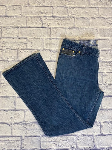 Bootheel Trading Co medium wash boot cut blue jeans.  Black leather detail on small front pocket and back pockets.