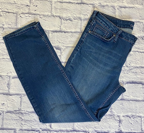 Calvin Klein ultimate skinny jeans in medium wash blue.  Zip and button closure.